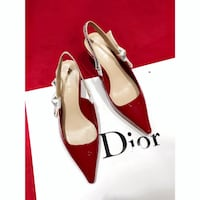 pair of white leather peep toe pumps Bronx County