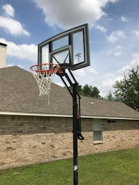 Red and black basketball hoop Lewisville, 75067
