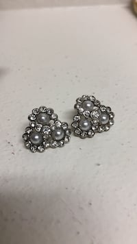 pair of silver-colored and gray pearl studded earrings
