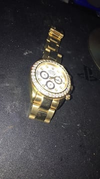 Round gold-colored chronograph watch with link bracelet 56 km