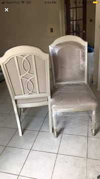 White wooden framed white padded chair