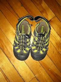 pair of black-and-yellow Nike running shoes Montréal, H4L 2X5