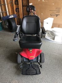 Red and black jazzy motorized wheelchair
