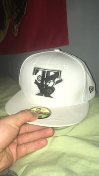 white and black New Era 59fifty cap