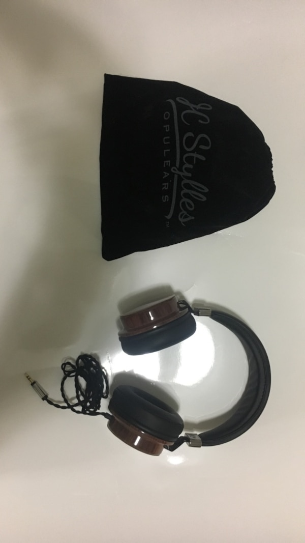 Black-and-brown corded headphones and black knit cap