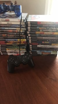 PlayStation 2 with a bunch of games and two controllers  Manassas, 20112
