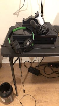 black Xbox One console with controller 1493 mi