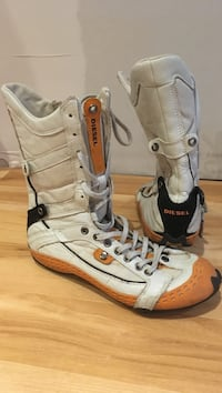 pair of orange-and-white Diesel boots