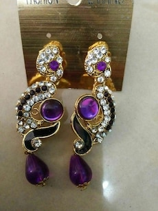 pair of gold silver and purple earrings