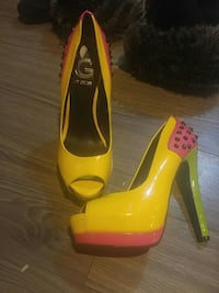 pair of yellow-pink-and-black peep-toe pumps Calgary, T2K