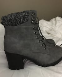 Gray suede like boots with sweater material around the ankle