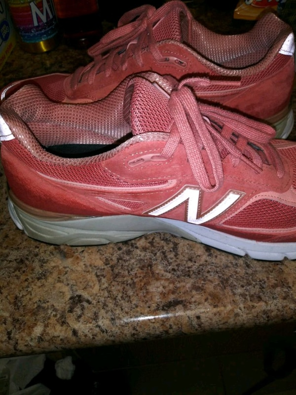 pair of red-and-white New Balance sneakers 01c4de22-de7f-43f2-a1c7-06a097b1eb1b