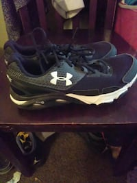 black-and-white Under Armour shoes