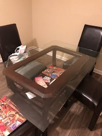 Glass dining room table. Chairs are in bad condition but could be repaired table is in good condition ! There's 5 chairs in total and needs to be picked up ASAP. Marietta