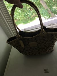 Lightly used coach hand bag Delta, 17314