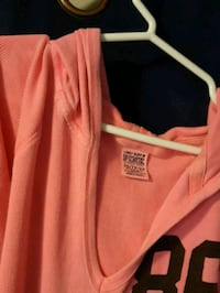 pink and white zip-up jacket 539 km