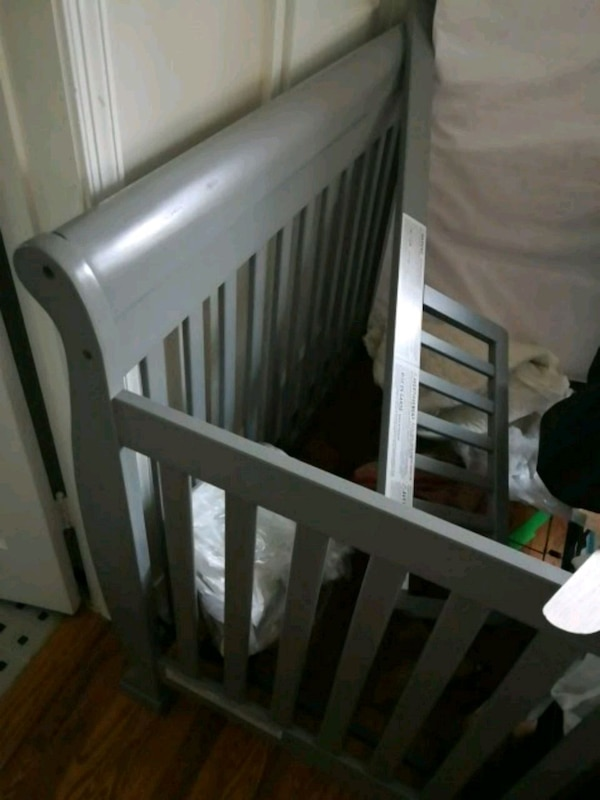 white wooden crib with changing table