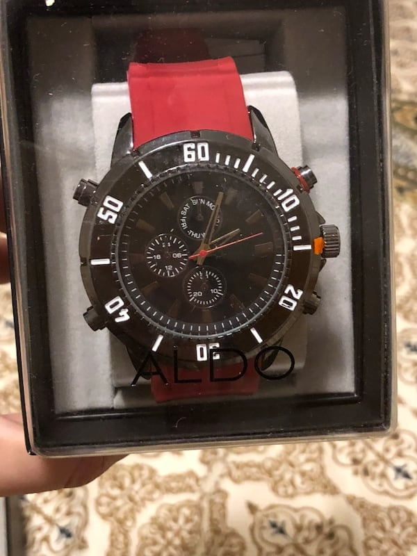 Round black chronograph watch with red leather strap 6b0a9962-57c8-4ab4-a485-7ea68af5ebac