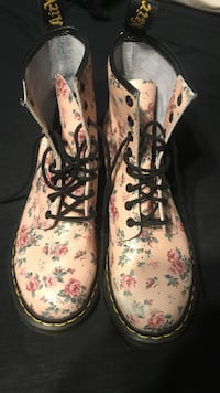 pair of brown-and-black floral boots