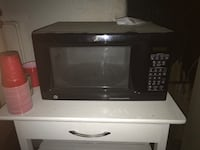 Black and gray microwave oven $35 obo Louisville, 40291