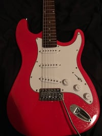 Red mahar Stratocaster style guitar and amp  Norfolk