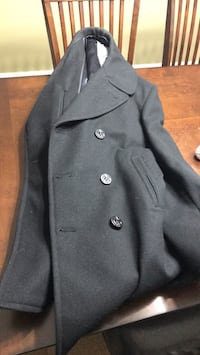 Navy Pea Coat. Excellent condition. Very warm. Used while in military Woodbridge, 22193