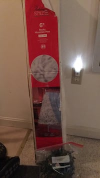 White 6 ft artificial tree with a string of red lights Winchester