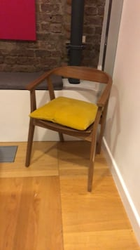 brown wooden framed red padded chair London, N1 9AB
