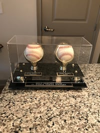 Autographed baseballs in display case. Signed by Yogi Berra and Don Larson. COA for both autographs. Kennesaw, 30144