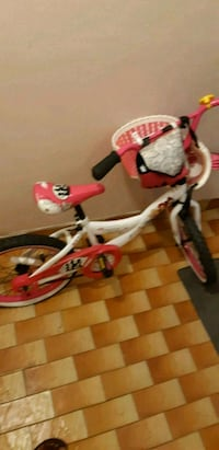 red and white bicycle with training wheels Montreal, H3S