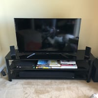 flat screen television with black wooden TV stand Arlington, 22209