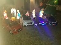 four assorted ride-on car toys