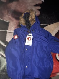blue and brown fur hooded jacket
