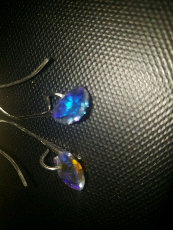 silver and blue gemstone pendant