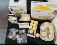 women's yellow and white Medela breast pump set with box