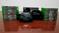 black Xbox One console with controller and game cases Toronto, M1P 4S3