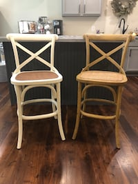 """Two french country wood counter height (24"""" tall from floor to seat) barstools with X-backs and rattan seating . One is white and one is stained. $85/both  Bourbonnais, 60914"""