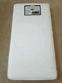 Crib mattress like new  protection cover, sheet
