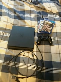 black Sony PS4 slim console with controller and ga Beaumont, T4X 2A7