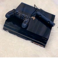 black Sony PS3 Slim with two controllers 128 mi