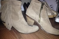 pair of brown leather fringe side-zip chunky-heeled boots