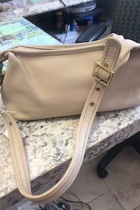 All leather beige Coach handbag can't beat this price.  Phillipsburg, 08865