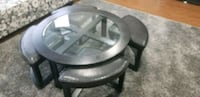 round clear glass-top table with gray steel base North Vancouver, V7J 1H6
