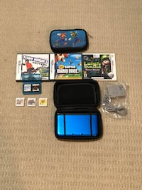 Nintendo 3DS XL charger, 9 games 2 carrying cases Ajax, L1Z 1E3