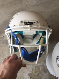 White and blue schutt football helmet & Rawlings shoulder pads Baton Rouge, 70809