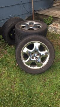 Used pt cruiser wheels and tires 205/55 r16 Remington