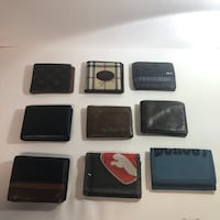 Assorted Men's wallets all for $60.