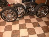 four chrome 5-spoke vehicle wheels and tires 52 km