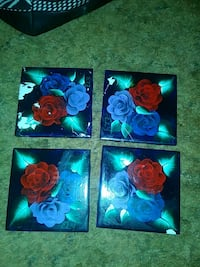 three assorted color floral print boxes Roswell, 88201