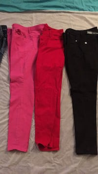 Pink pants $10.00 red pants $10.00 black pants with rips in the knees $10.00 Yuma, 85364